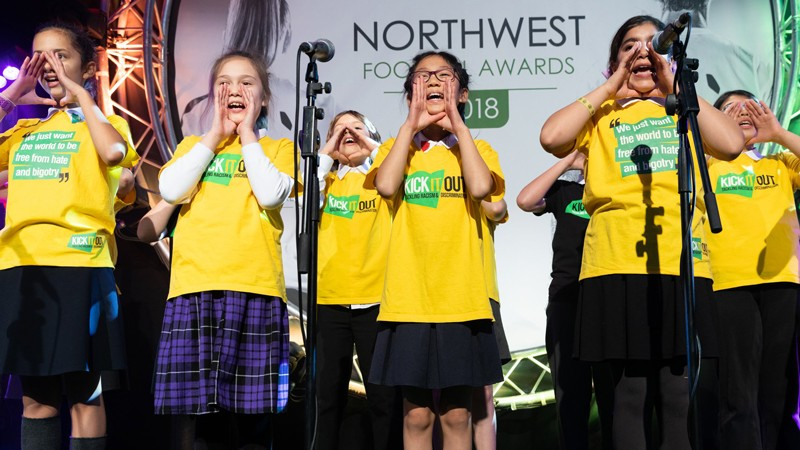 Singers cup hands around their mouths to 'spreading the word'
