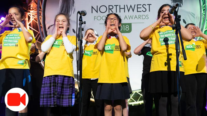 Singers cup hands around their mouths to 'spreading the word' - includes video icon